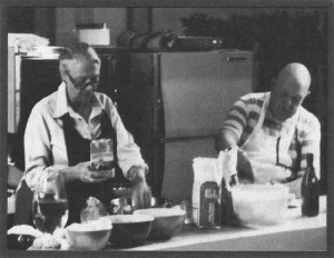 Marion Cunningham assisting James Beard in the kitchen